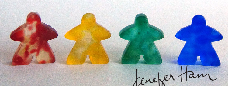 sandblasted meeples by Jenefer Ham